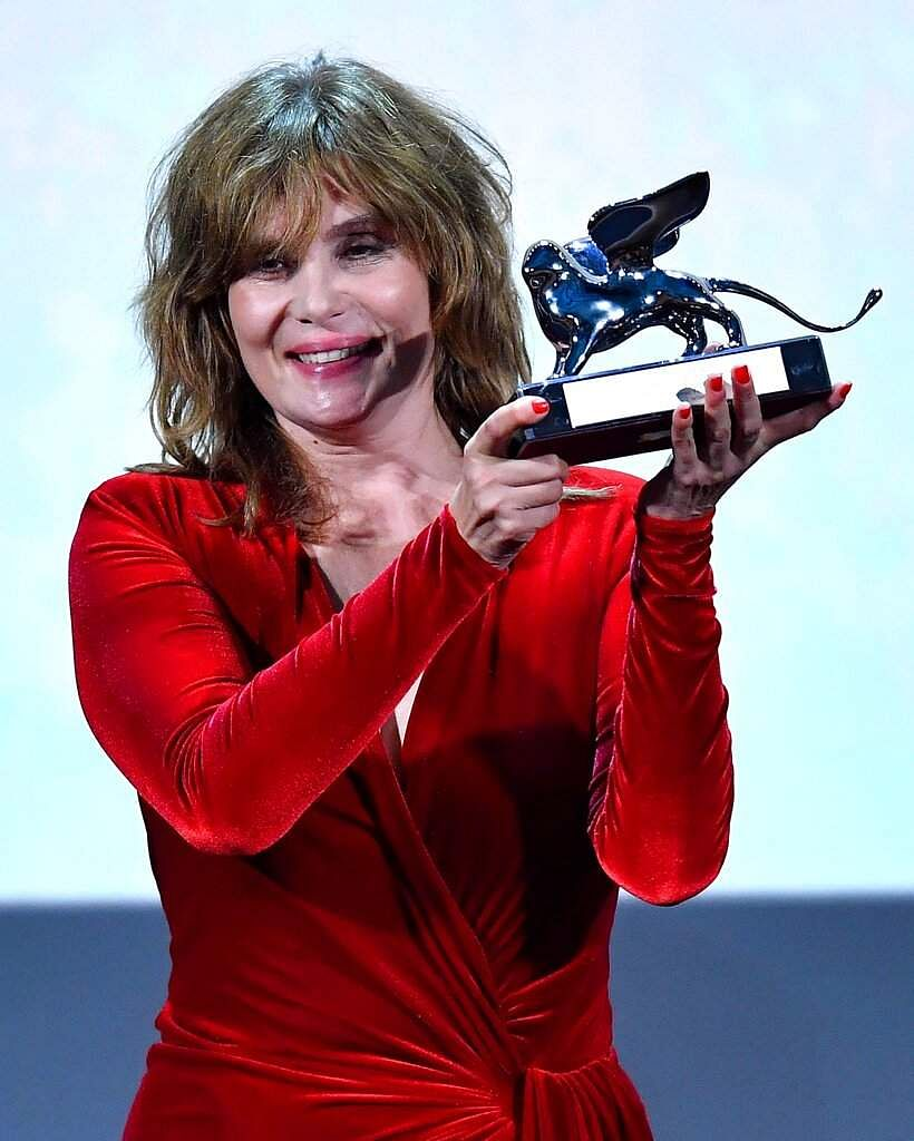 French actress, model and singer, Emmanuelle Seigner receives the Grand Jury Prize for J'Accuse directed by Roman Polanski. (Ettore Ferrari/ANSA via AP)