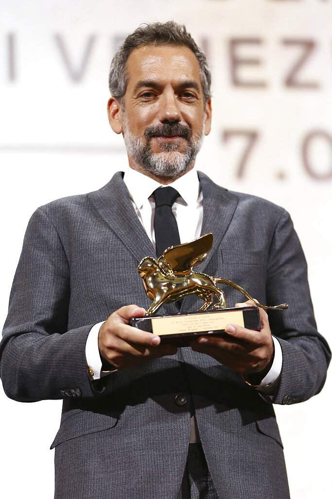 Director Todd Phillips holds the Golden Lion for Best Film for Joker at 76th edition of the Venice Film Festival. (Photo by Joel C Ryan/Invision/AP)