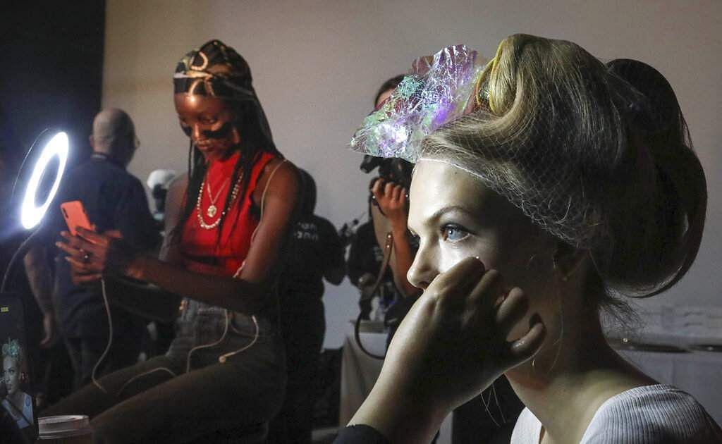 Stylist prepare models for the runway show unveiling the latest creations from Brandon Maxwell, at New York Fashion Week, in the Brooklyn borough of New York. (AP Photo/Bebeto Matthews)