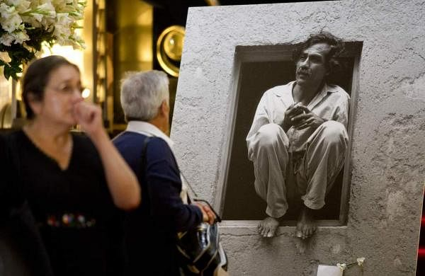 2004 file photo: The late artist Francisco Toledo eats a corn tortilla in Oaxaca, Mexico, to protest the presence of genetically modified corn in the Mexican wild. (AP Photo/Marco Ugarte, File)