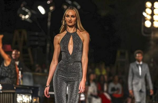 Candice Swanepoel models the Tommy Hilfiger collection during Fashion Week in New York, Sunday, Sept. 8, 2019. (AP Photo/Jeenah Moon)