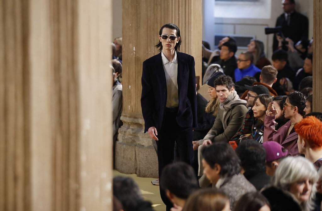 A model wears a creation part of the Salvatore Ferragamo men's Fall-Winter 2020/21 collection, that was presented during the fashion week, in Milan, Italy, Sunday, Jan 12, 2020. (AP Photo/Luca Bruno)