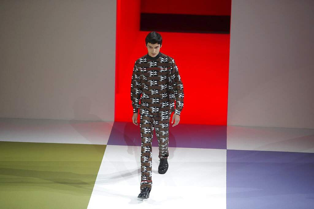 A model wears a creation as part of the Prada men's Fall-Winter 2020/21 collection, that was presented in Milan, Italy, Sunday, Jan 12, 2020. (AP Photo/Antonio Calanni)