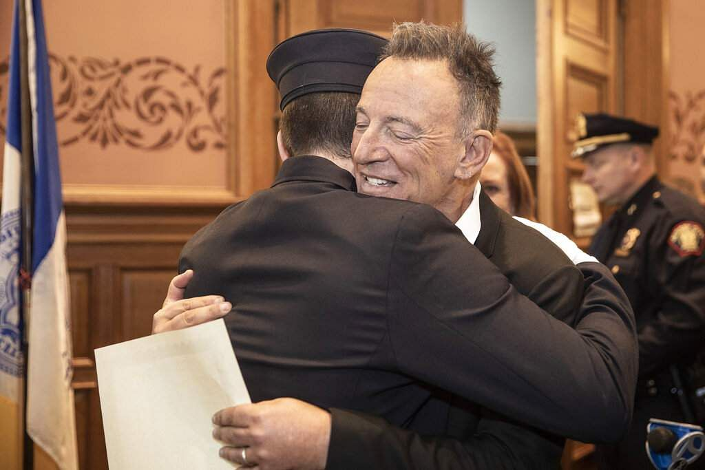 Bruce Springsteen hugs his son Sam (Jennifer Brown/Jersey City Mayor's Office via AP)