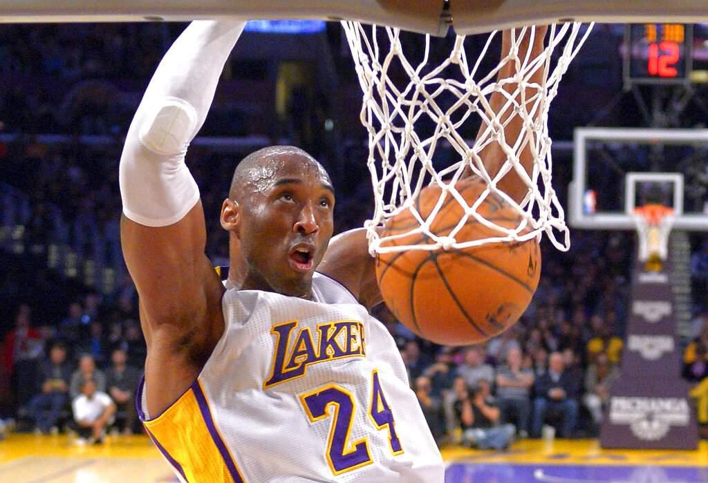 Jan 4, 2015: Kobe Bryant dunks at a game in LA (AP Photo/Mark J. Terrill)