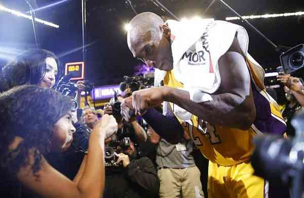 April 13, 2016: Kobe Bryant fist-bumps his daughter Gianna (AP Photo/Jae C. Hong, File)