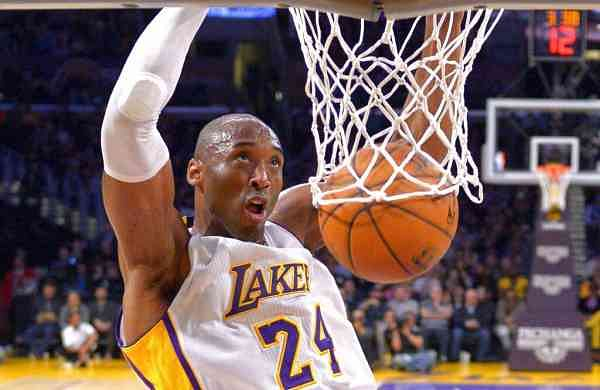 Jan 4, 2015: Kobe Bryant dunks at a game in LA (AP Photo/Mark J. Terrill)