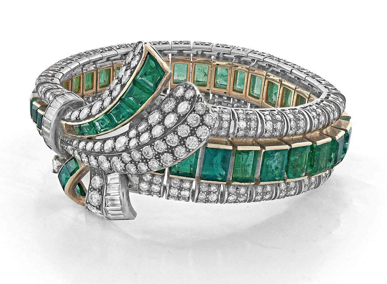 Lot_31_-_A_Vintage_Diamond_and_Emerald_Bracelet,_circa_1940,_Estimate_-_INR_35_-_40_lakhs_(US�_49,296_–_56,338)