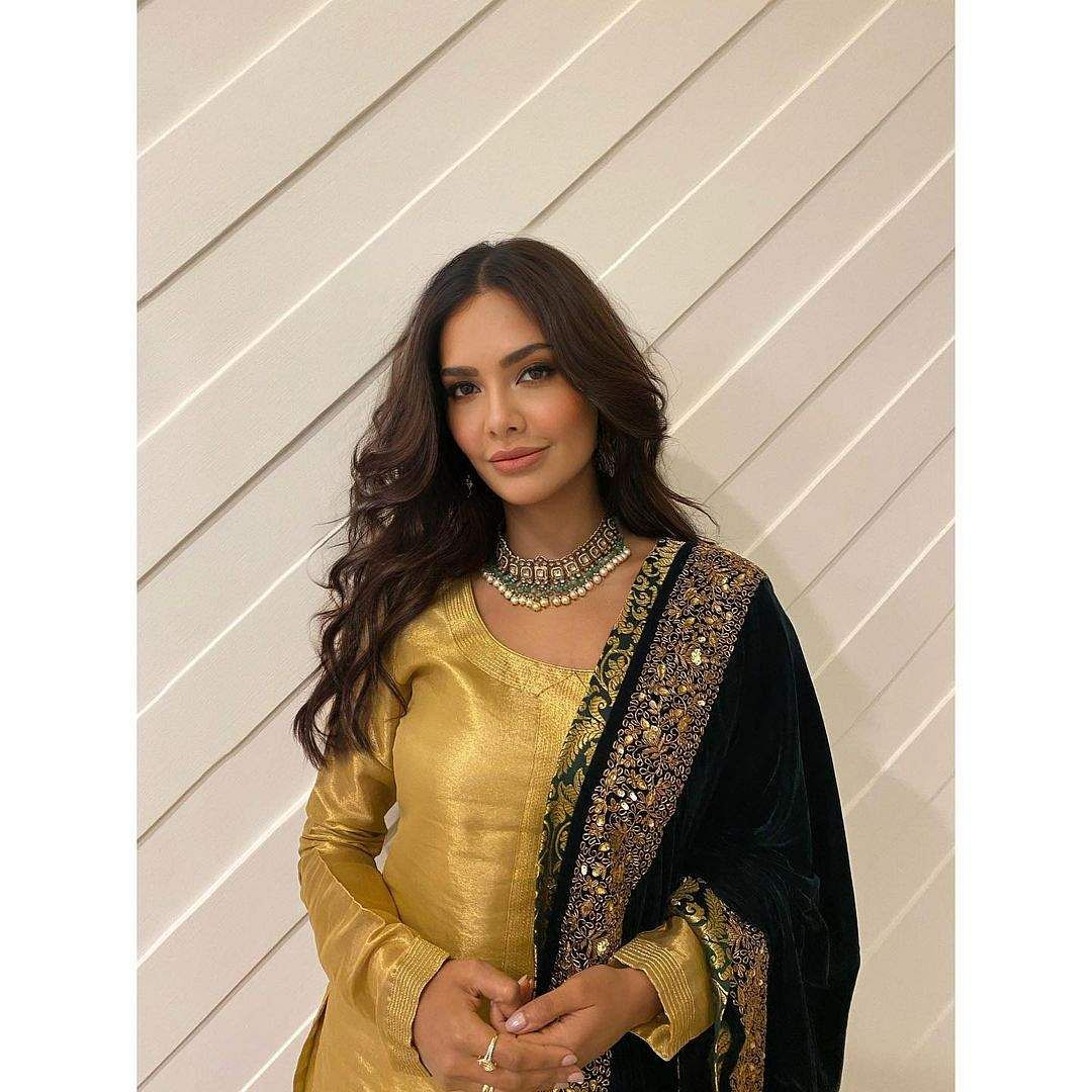 Esha wore a chic yellow raw silk sharara by luxury occasion wear label Ranian by Neha Gupta, and she teamed it up with a low-key jadau and pearl neckpiece