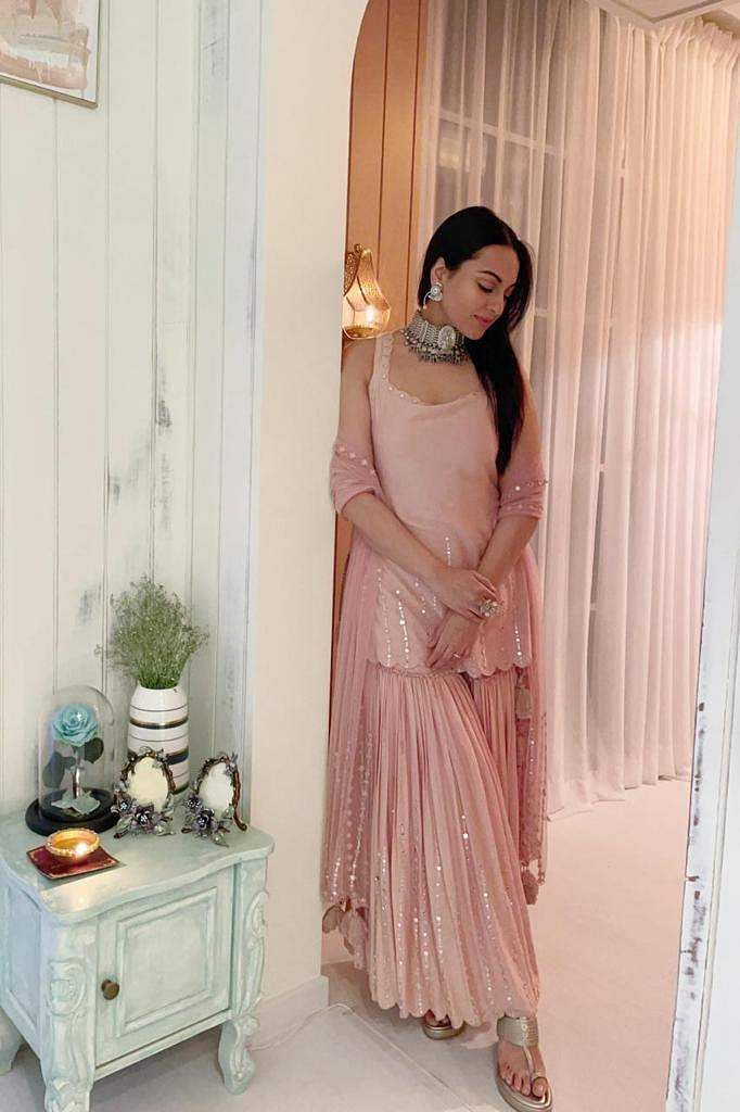 Sonakshi Sinha wore a pastel pink sharara set with scalloped hems, from Sukriti & Aakriti and paired it with an edgy, vintage silver choker by Lara Morakhia