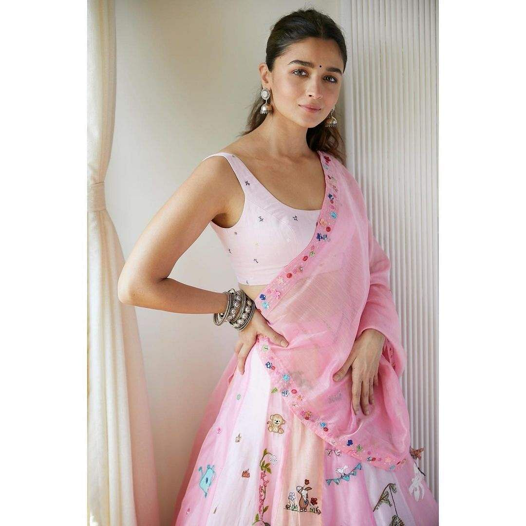 Alia Bhatt wore a zero-waste candy pink lehenga made by Madhurya Creations, featuring a collection of drawings made by 35 children studying in free schools of AOL