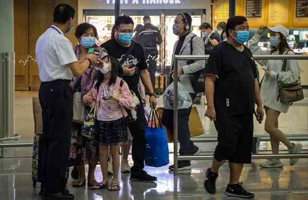 Travellers at Hong Kong Airport (AFP/Vivek Prakash)
