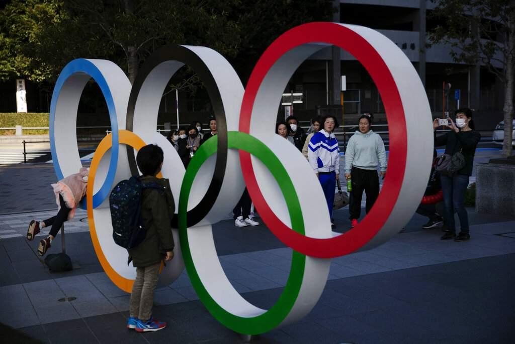Olympic rings near the New National Stadium, Tokyo (AP Photo/Jae C Hong)