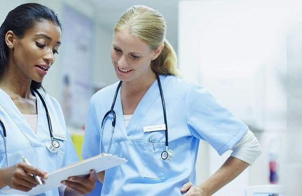 nurses-discussing-over-documents-in-hospital-493216353-595690893df78c4eb647536e-5bd78e3446e0fb0051debf7f