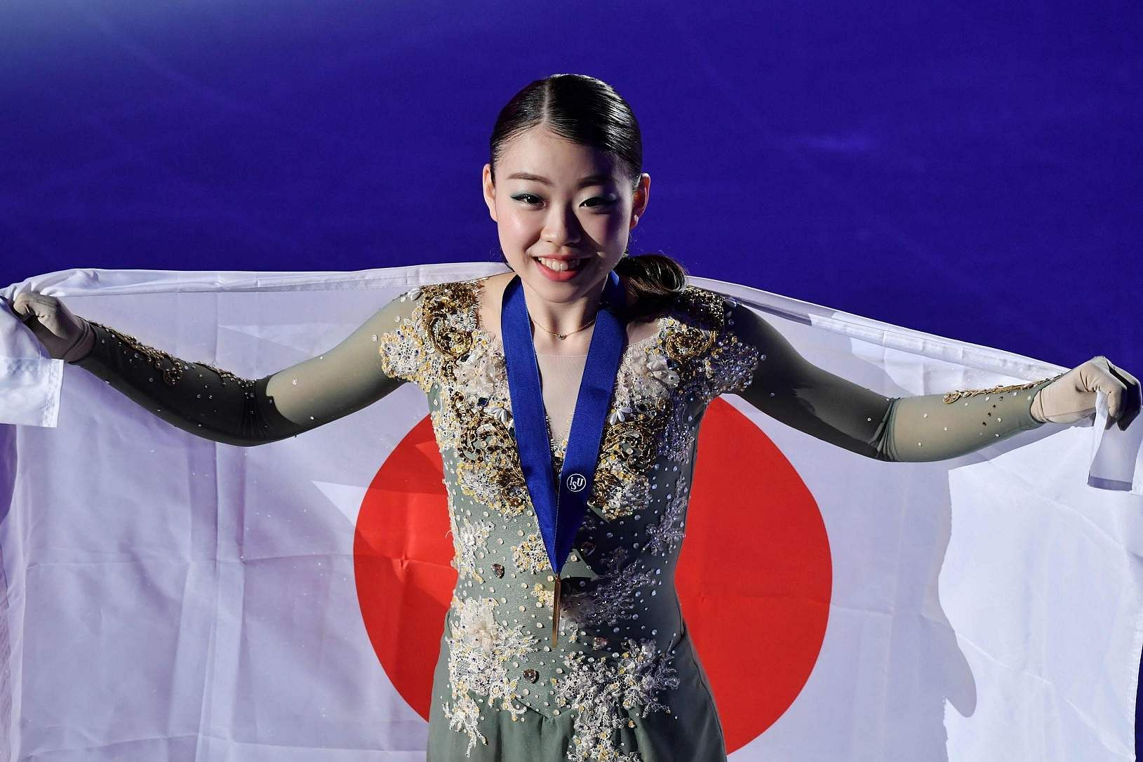 Seoul: Gold medalist Rika Kihira of Japan poses during the medal ceremony for the ladies single free skating at the ISU Four Continents Figure Skating Championships in Seoul / AFP / Jung Yeon-je