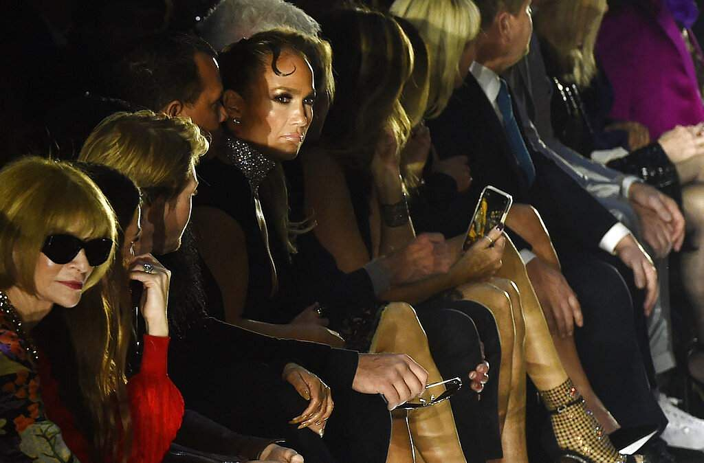 Celebrity guests Jennifer Lopez and Anna Wintour watch from the front row at the NYFW Fall/Winter 2020 - Tom Ford fashion show at Milk Studios, Feb 7, 2020, in LA. (AP Photo/Chris Pizzello)