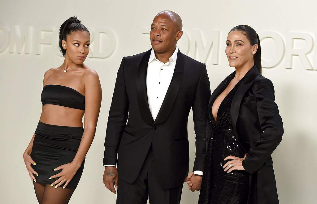 Truly Young, Dr Dre and Nicole Young attend the Tom Ford show at Milk Studios during NYFW Fall/Winter 2020 on Friday, Feb 7, 2020, in Los Angeles. (Photo by Jordan Strauss/Invision/AP)