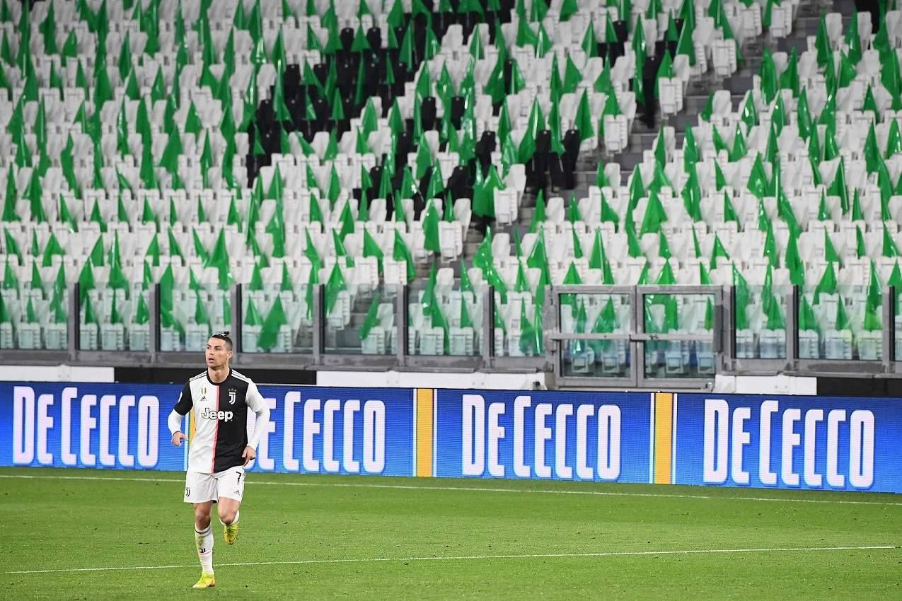 Cristiano Ronaldo an empty Juventus stadium (AFP/Vincenzo PINTO)