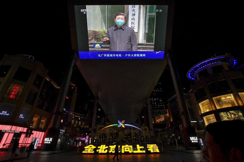 A giant TV screen broadcasts an address by Chinese President Xi Jinping in Beijing. (AP Photo/Andy Wong)