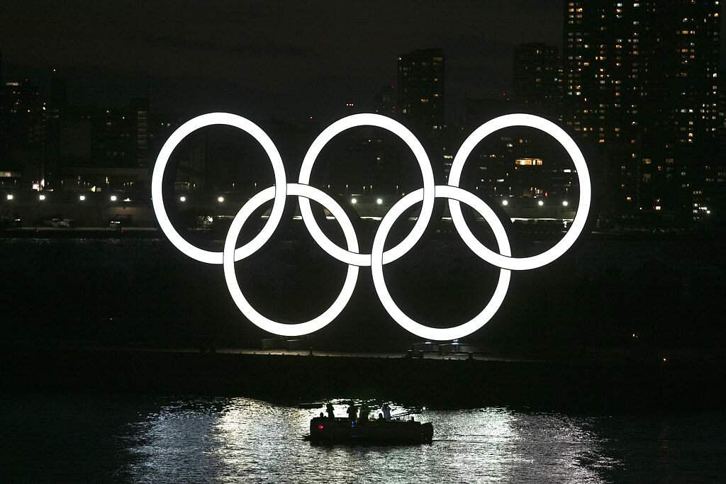 People in a boat view the Olympic rings in the Odaiba section of Tokyo, Japan. (AP Photo/Jae C Hong)