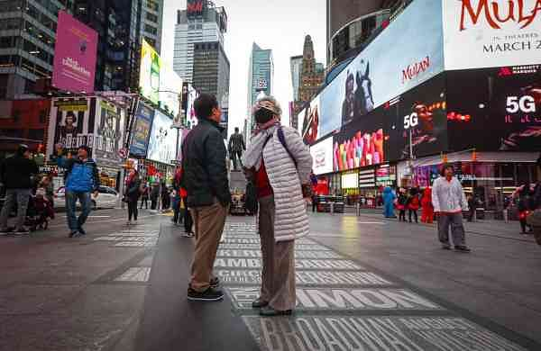 At Times Square, New York (AP Photo/John Minchillo)