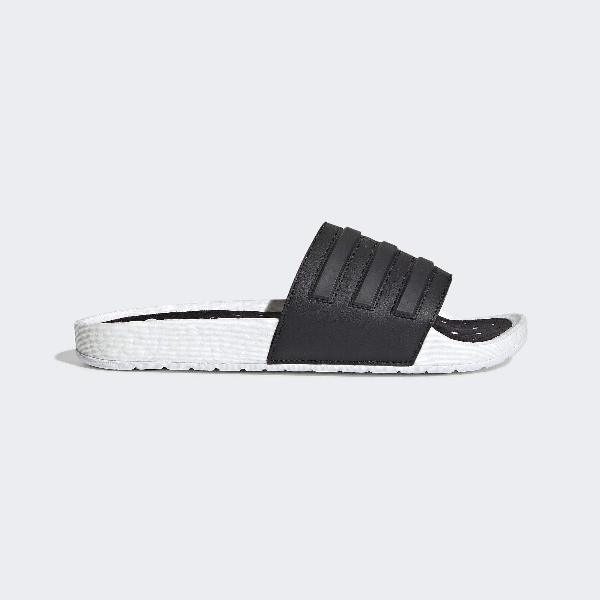 Adidas Boost sandal: These slides are super comfy with a Responsive boost midsole for supreme cushioning. They also provide energy-return so you can wear them all day long. INR 4,999.
