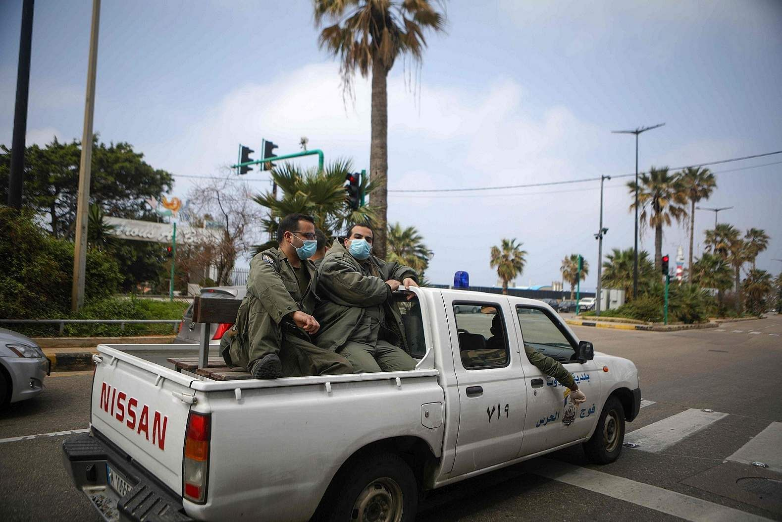 Beirut: Police patrol a street in the Lebanese capital as the government urged people to stay at home and prepared to close its main airport to stem the coronavirus outbreak. (AFP/PATRICK BAZ)