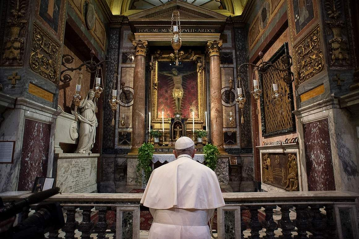 Rome: Pope Francis prays at S Marcello al Corso church, where there's said to be a miraculous crucifix that in 1552 was carried around Rome to stop the great plague. (AFP/VATICAN MEDIA)