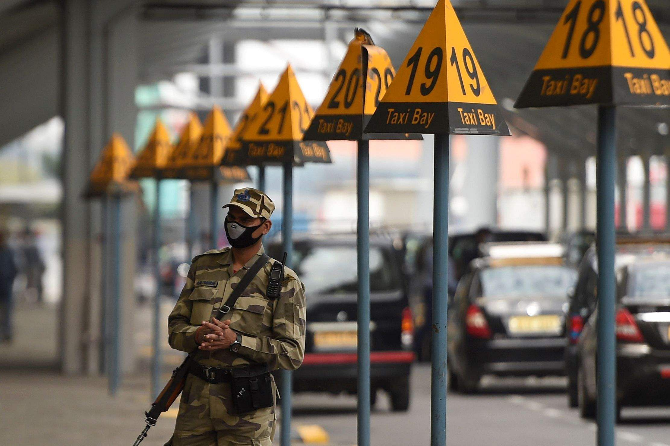 New Delhi: A security personnel wearing a face mask stands guard outside at the Indira Gandhi International Airport in New Delhi. (AFP/Money SHARMA)