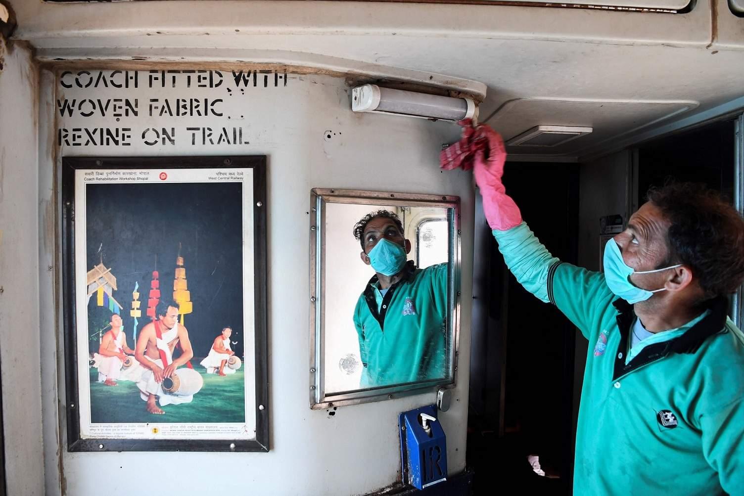New Delhi: A railway worker cleans a train carriage as a preventive measure against the COVID-19 coronavirus at a yard in New Delhi. (AFP/Sajjad HUSSAIN)
