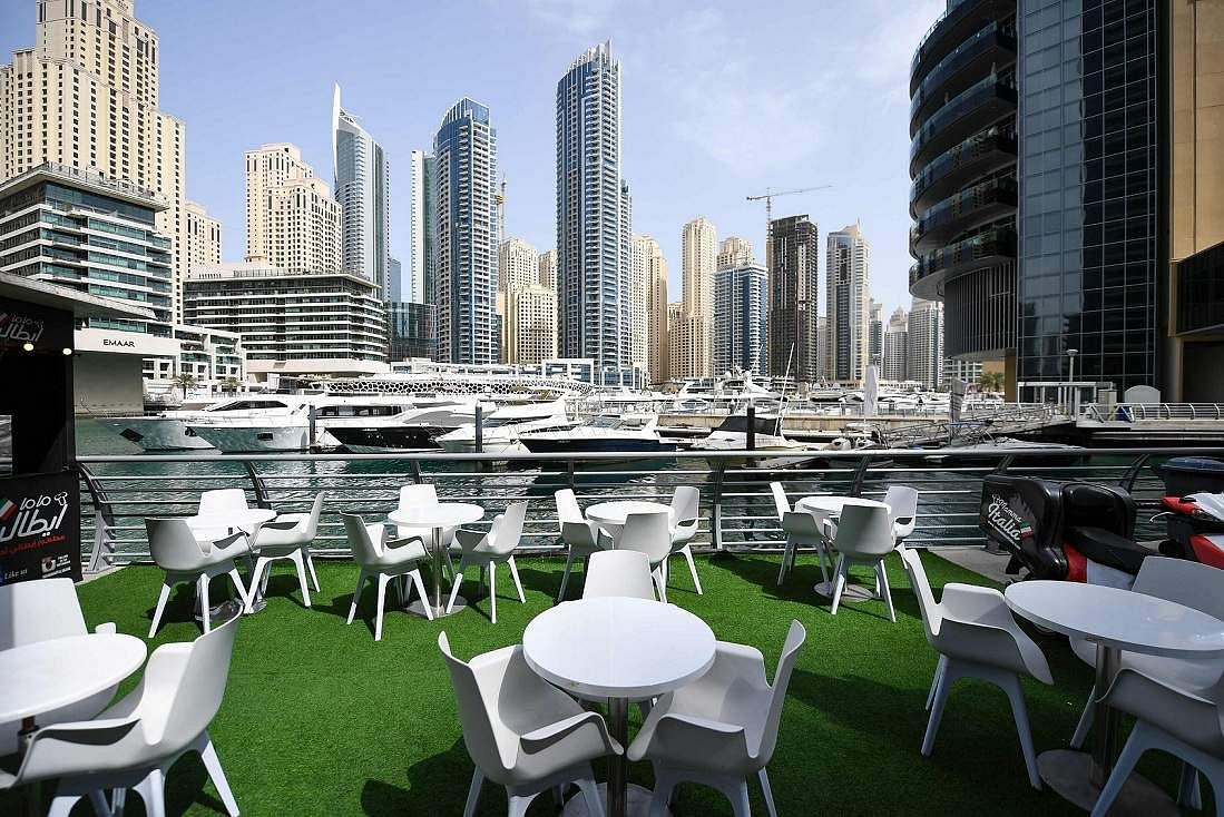 Dubai: Tables and chairs at a restaurant in Dubai's marina. The new coronavirus outbreak has turned life upside down in Gulf societies. (AFP/KARIM SAHIB)