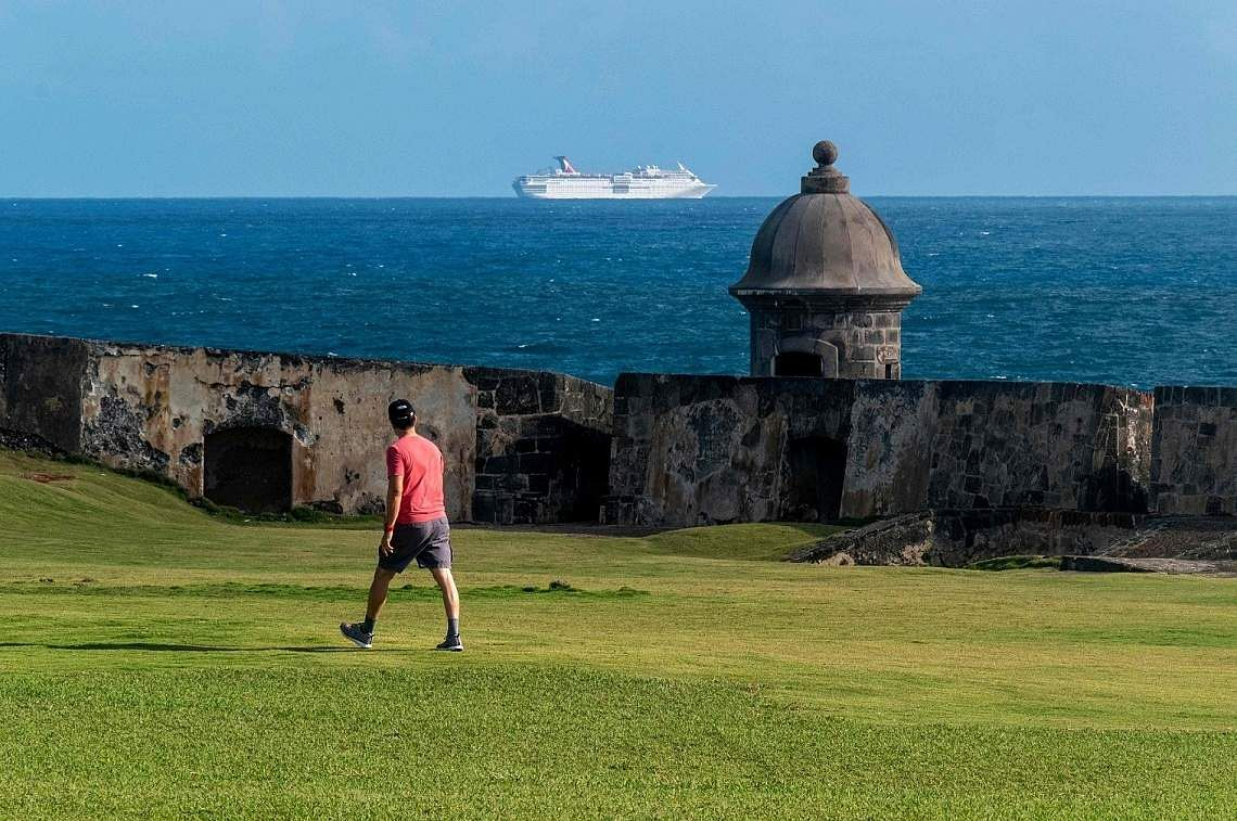 San Juan: The Carnival Fascination cruise ship is held off the coast of Puerto Rico with 2,500 passengers onboard before being denied to dock in San Juan. (AFP/Ricardo ARDUENGO)