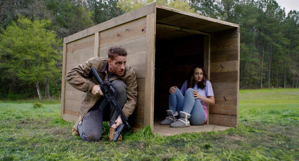Justin Hartley and Sylvia Grace Crim in The Hunt (Universal Pictures via AP)