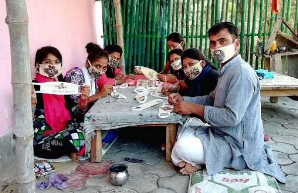 Bihar couple use Madhubani art on face masks to write anti-coronavirus slogans