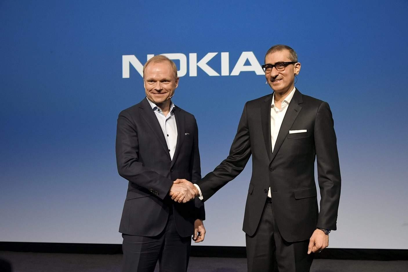 Pekka Lundmark and Rajeev Suri (AFP/Lehtikuva/Markku Ulander)