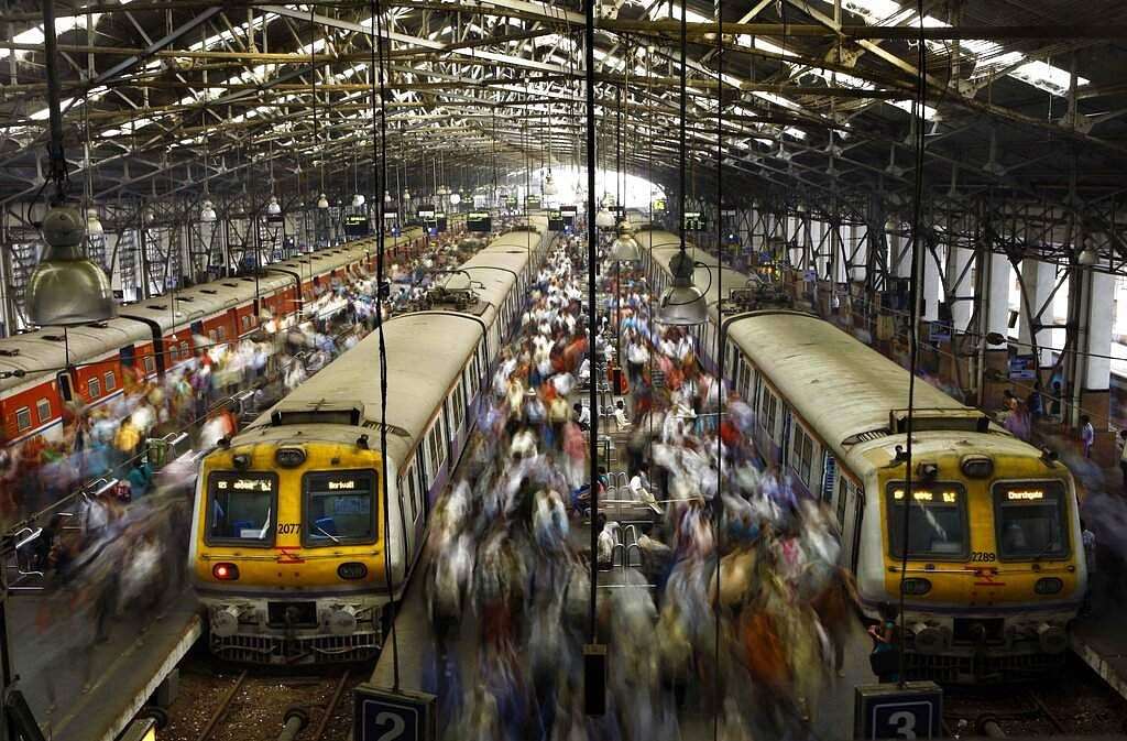 File photo: Commuters get off trains at the Church Gate railway station in Mumbai. (AP Photo/Rafiq Maqbool, File)