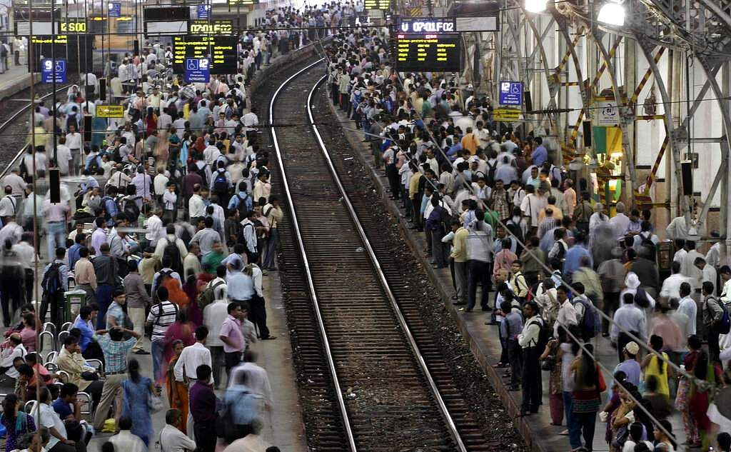 File photo: Commuters wait for trains at the Churchgate railway station in Mumbai. (AP Photo/Rajanish Kakade, File)