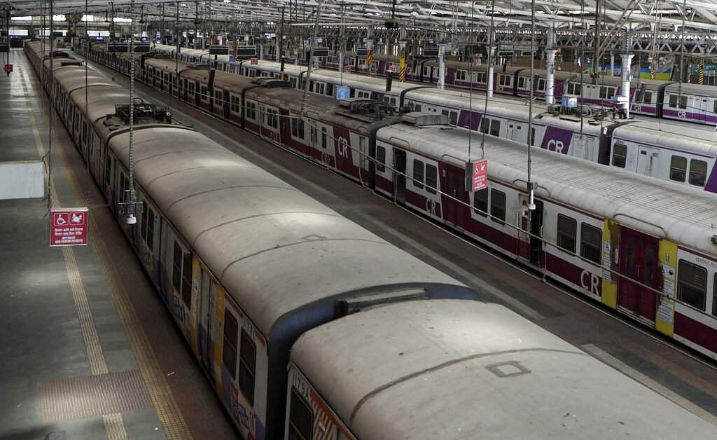 Trains stand parked at Chhatrapati Shivaji Maharaj Terminus after India's colossal passenger railway system has come to a halt. (AP Photo/Rajanish Kakade)