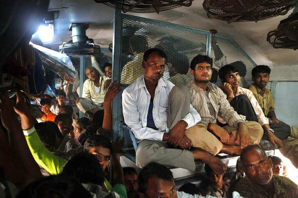 File photo: Passengers travel in an overcrowded train at the New Delhi railway station. (AP Photo/Manish Swarup, File)