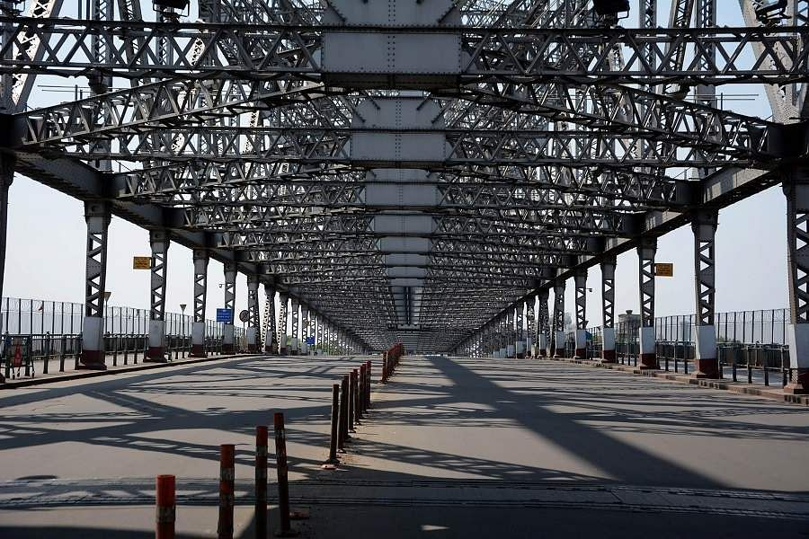 Kolkata: Howrah Bridge bears a deserted look during the complete nationwide lockdown imposed to contain the coronavirus pandemic. (Photo: IANS)
