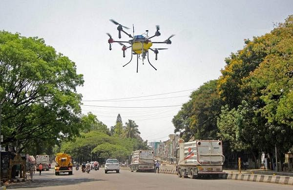 Drones deployed by the Bengaluru civic body spray disinfectants across the city during the complete lockdown imposed across the country to contain the spread of the coronavirus. (Photo: IANS)