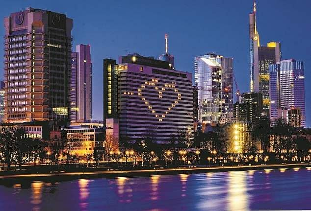 Frankfurt, Germany: A hotel switches on the lights in some rooms to form the shape of a heart. (AP Photo/Michael Probst)