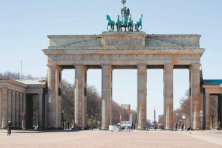 Berlin, Germany: A protester stages an installation at Pariser Platz by the Brandenburg Gate. (AFP/Odd Andersen)