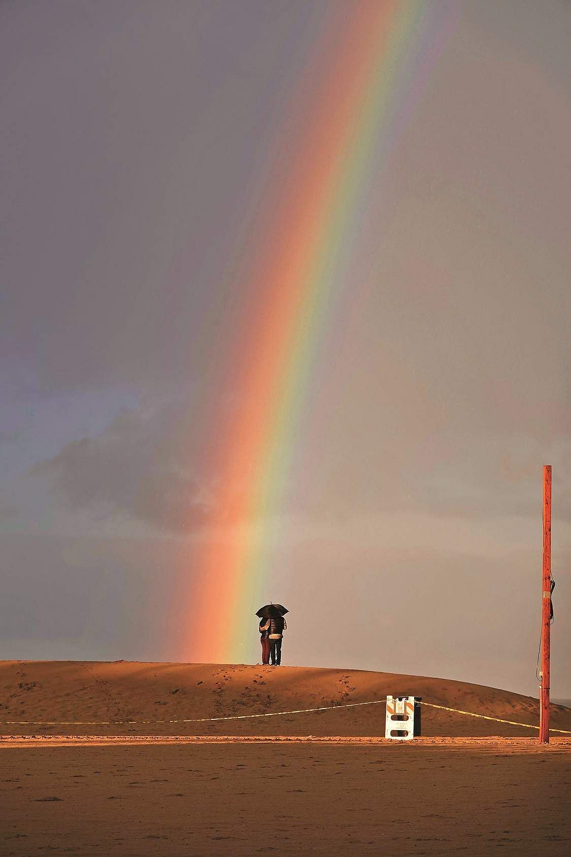 Santa Monica, California, US: A rainbow appears offshore in Santa Monica. If it appeared like a hopeful sign, there was no pot of gold for the local tourism industry. (AFP/Bill Greenslade)