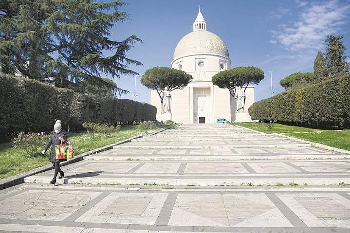 Rome, Italy: A woman walks in front of the St Peter and Paul church in Rome. (AP Photo/Alessandra Tarantino)
