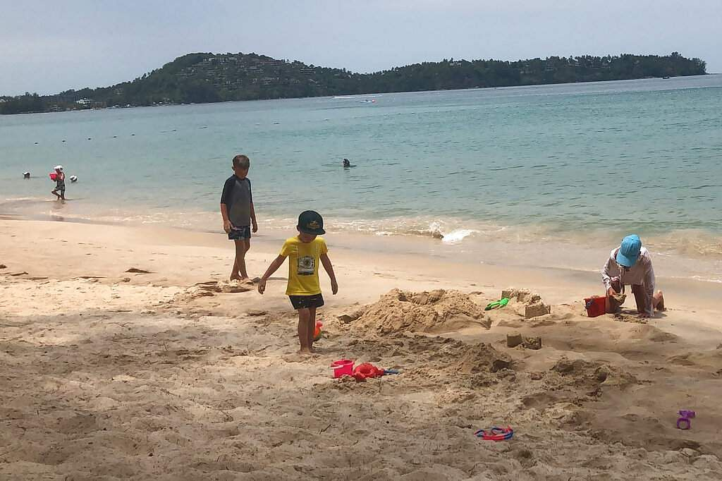 Visitors swim on a beach in Phuket, Thailand, in the last week of March 2020, even as tourists across Asia find their dream vacations have turned into travel nightmares. (AP Photo/Penny Wang)