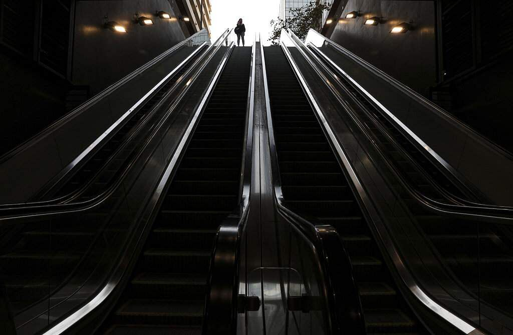 Santiago, Chile: A woman stands at the entrance of a largely empty metro station in Santiago, during a quarantine to contain the new coronavirus. (AP Photo/Esteban Felix)