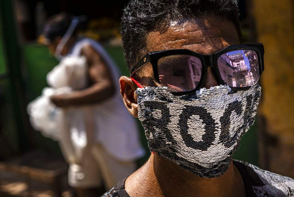 Old Havana, Cuba: A youngster wears a homemade face mask, featuring sequence fabric and the word 'Rock', in Old Havana. (AP Photo/Ramon Espinosa)