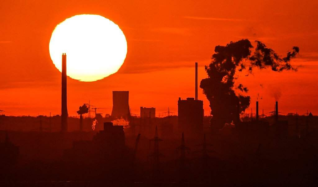 Bochum, Germany: The sun sets over the Industrial Ruhr valley. The economic shutdown caused by the coronavirus is threatening to plunge Germany's crucial industrial sector. (AP Photo/Martin Meissner)