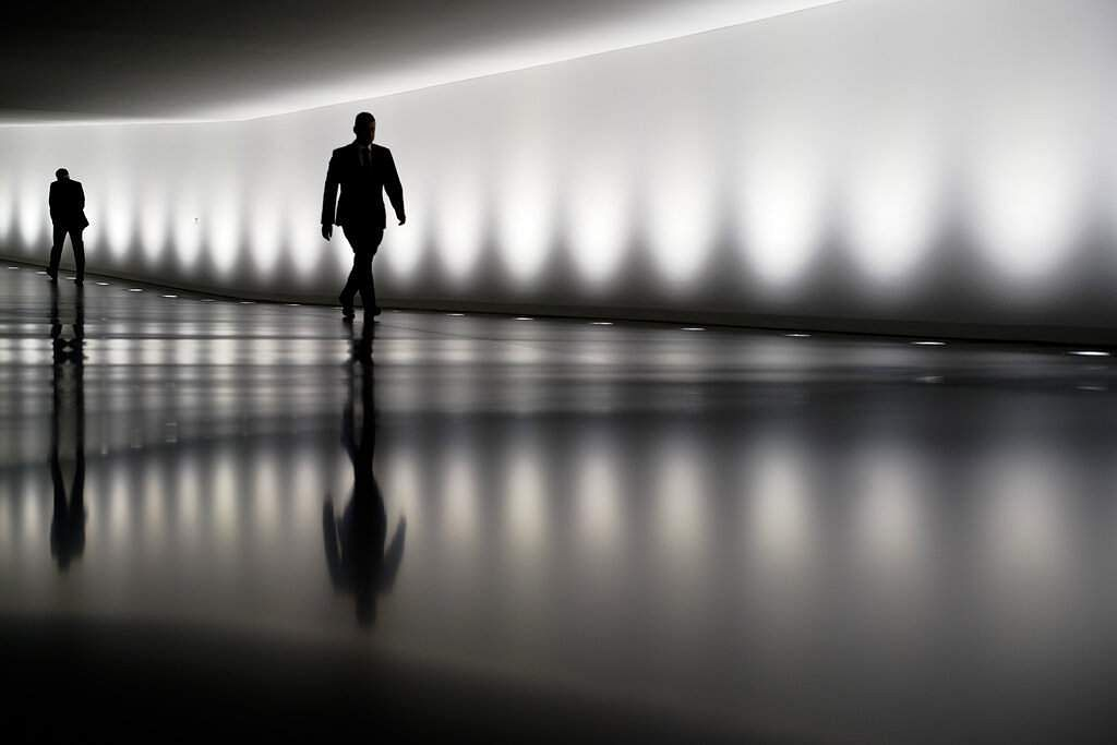 Berlin, Germany: Two persons walk through a tunnel between the plenary hall and an office building of the German parliament Bundestag in Berlin. (AP Photo/Markus Schreiber)